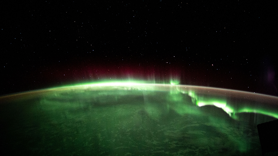 An aurora is pictured streaming above the Indian Ocean in between Australia and Antarctica on April 19, 2021.