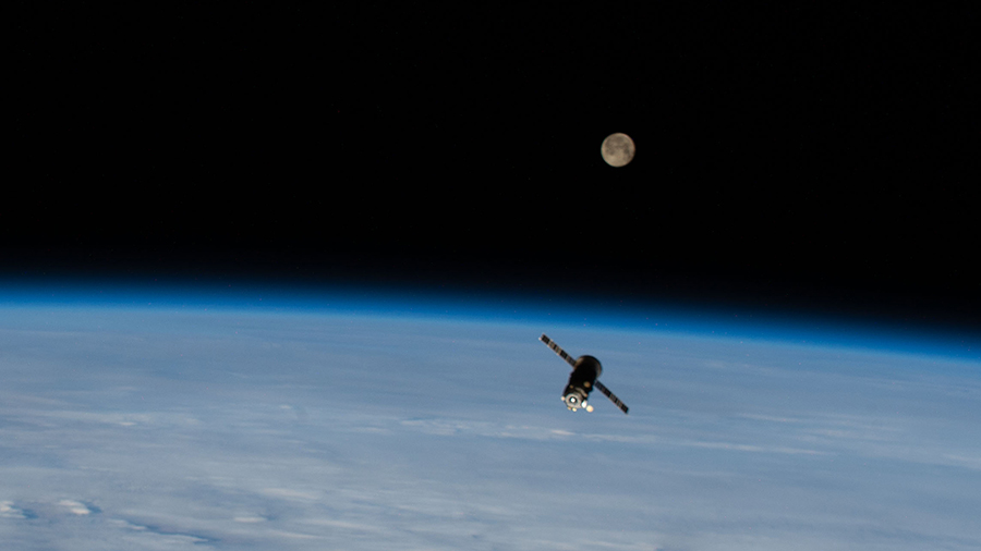 Russia's ISS Progress 75 resupply ship is pictured with a Full Moon above the Earth's horizon after undocking from the station. Credits: NASA