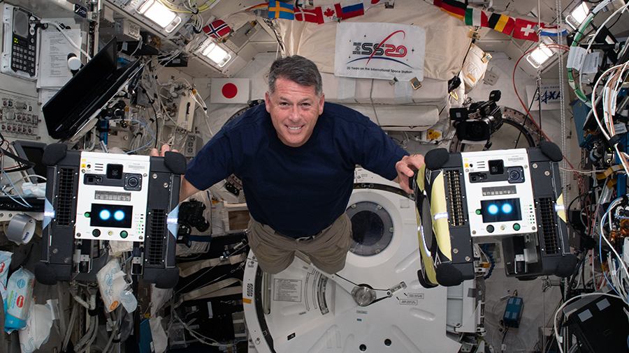NASA astronaut Shane Kimbrough is pictured inside the Kibo laboratory module with the Astrobee free-flying robotic assistants. Credits: NASA