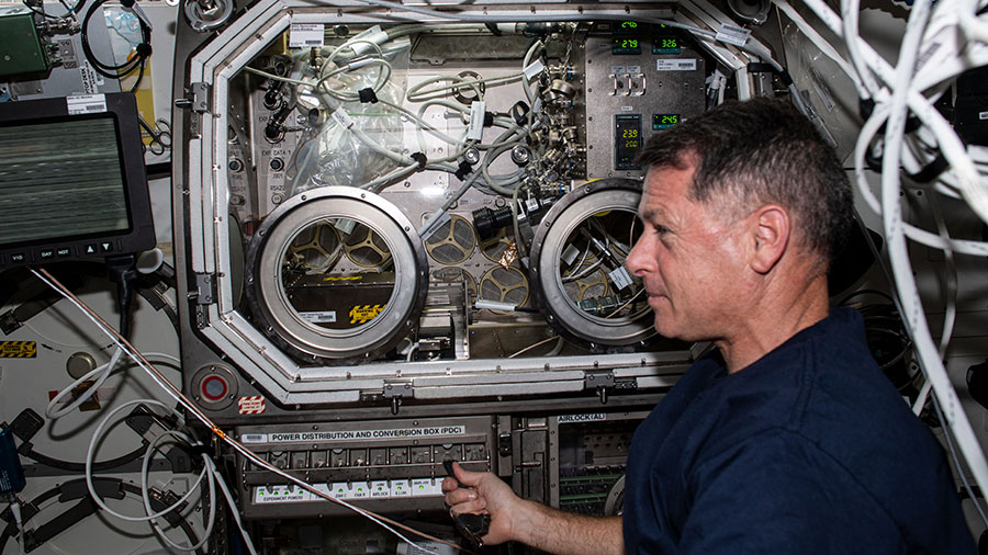 NASA astronaut Shane Kimbrough sets up hardware for the SUBSA physics investigation in the Microgravity Science Glovebox.
