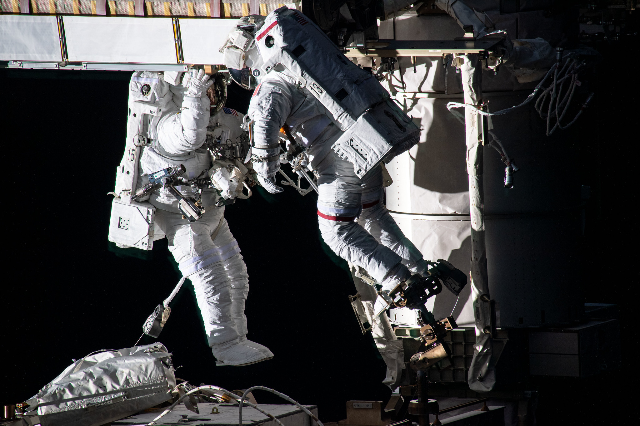 Spacewalkers (from left) Shane Kimbrough and Thomas Pesquet work to install new roll out solar arrays on the International Space Station's P-6 truss structure on June 16, 2021.