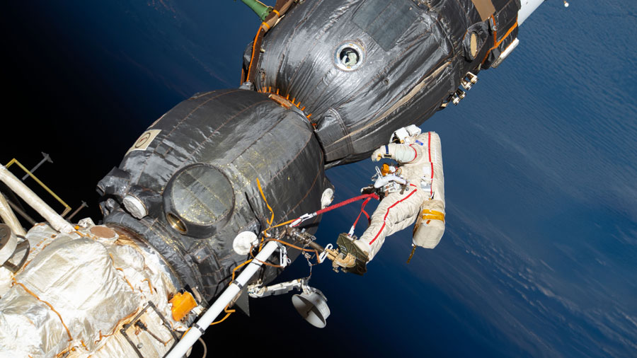 Cosmonaut Oleg Kononenko is pictured in an Orlan spacesuit with red stripes during a spacewalk in Dec. 11, 2018, to inspect the Soyuz MS-09 crew ship.