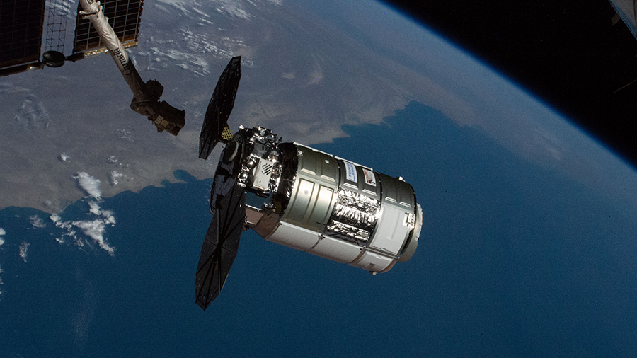 The Cygnus space freighter is pictured moments before its capture with the Canadarm2 robotic arm on Feb. 22, 2021.