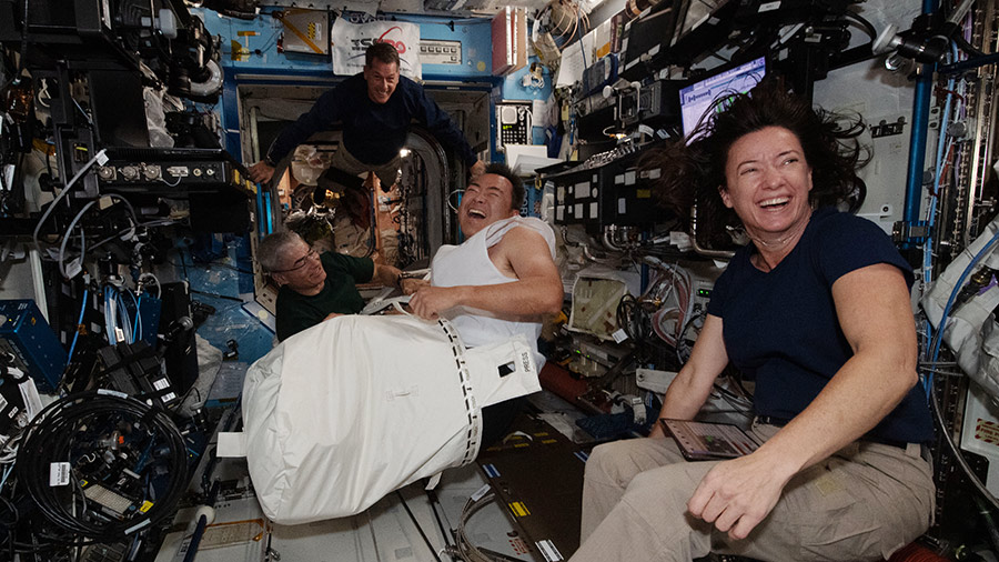Expedition 65 astronauts (from right) Megan McArthur, Akihiko Hoshide, Shane Kimbrough and Mark Vande Hei share a light moment aboard the space station.