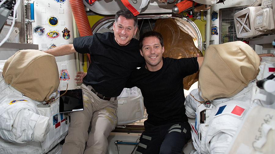 Astronauts Shane Kimbrough (from left) and Thomas Pesquet pose for a portrait while working on U.S. spacesuits.