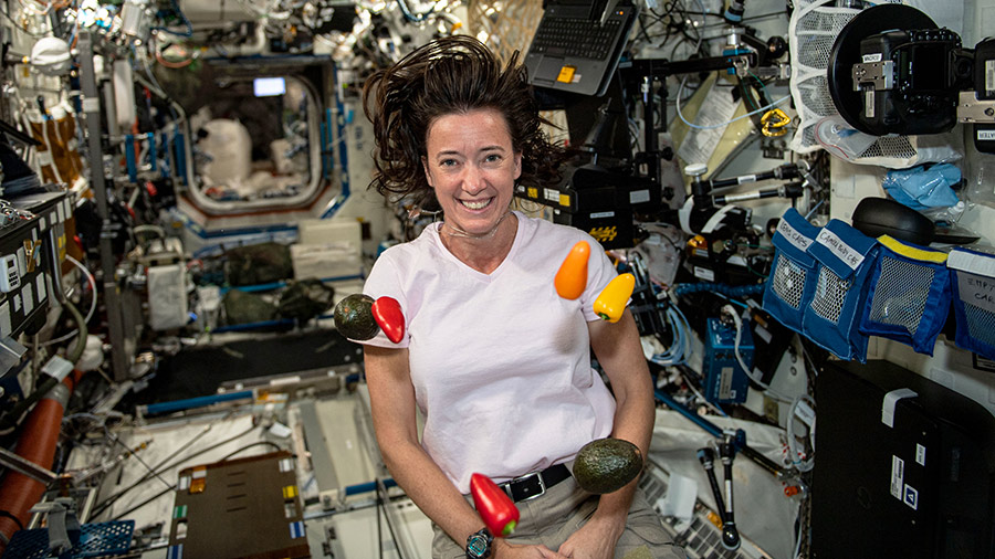 NASA astronaut Megan McArthur seemingly juggles fresh peppers and avocados that were just delivered to the station aboard the SpaceX Crew Dragon resupply ship.