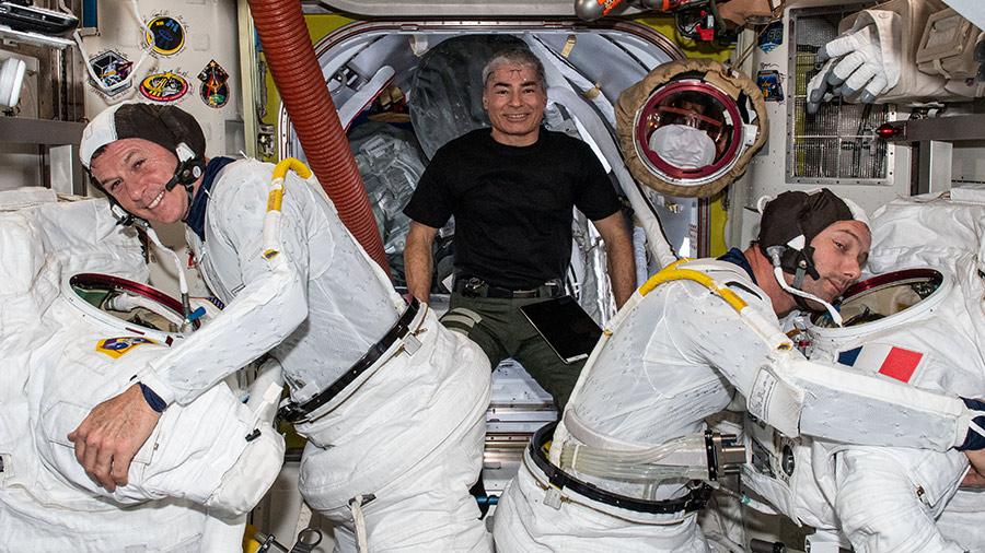 Astronaut Mark Vande Hei poses for a playful portrait with astronauts Shane Kimbrough (left) and Thomas Pesquet (right) who are trying on their U.S. spacesuits.