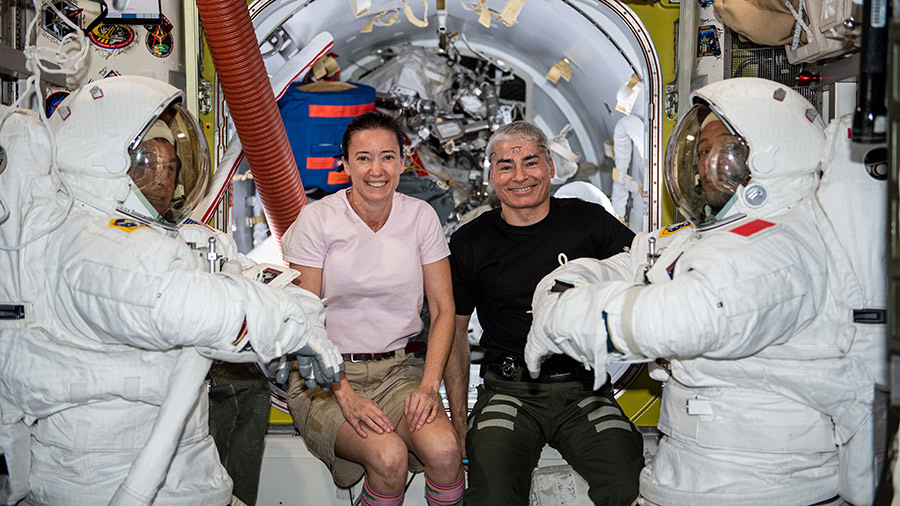 At center, Expedition 65 Flight Engineers Megan McArthur and Mark Vande Hei pose with astronauts Shane Kimbrough (far left) and Thomas Pesquet (far right) who are in U.S. spacesuits.