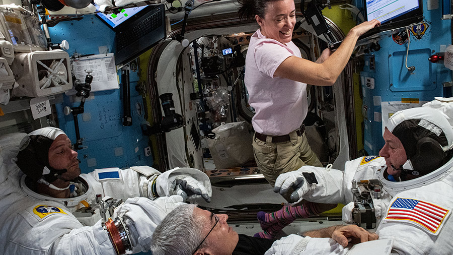 Expedition 65 Flight Engineers Megan McArthur and Mark Vande Hei support astronauts Thomas Pesquet (left) and Shane Kimbrough (right) as they test their U.S. spacesuits for a fit verification.