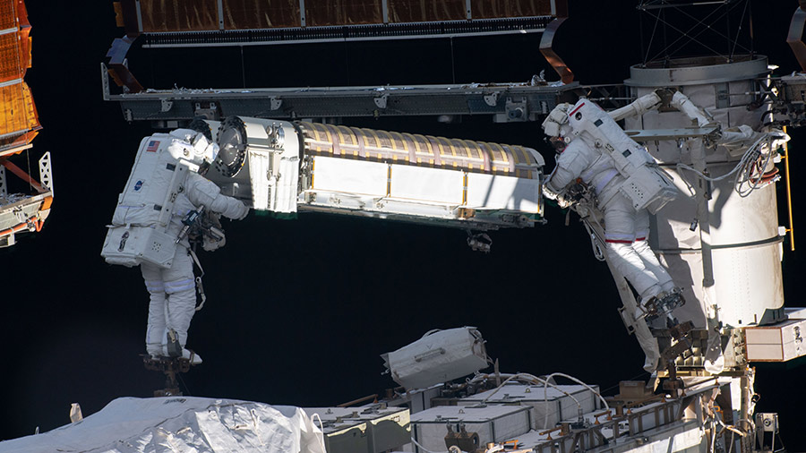 Spacewalkers (from left) Shane Kimbrough and Thomas Pesquet work to install new roll out solar arrays on the International Space Station's P-6 truss structure.