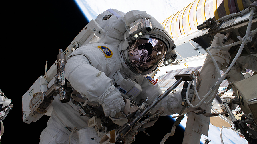 NASA spacewalker Shane Kimbrough is pictured during a spacewalk to install new roll out solar arrays on the International Space Station's Port-6 truss structure.