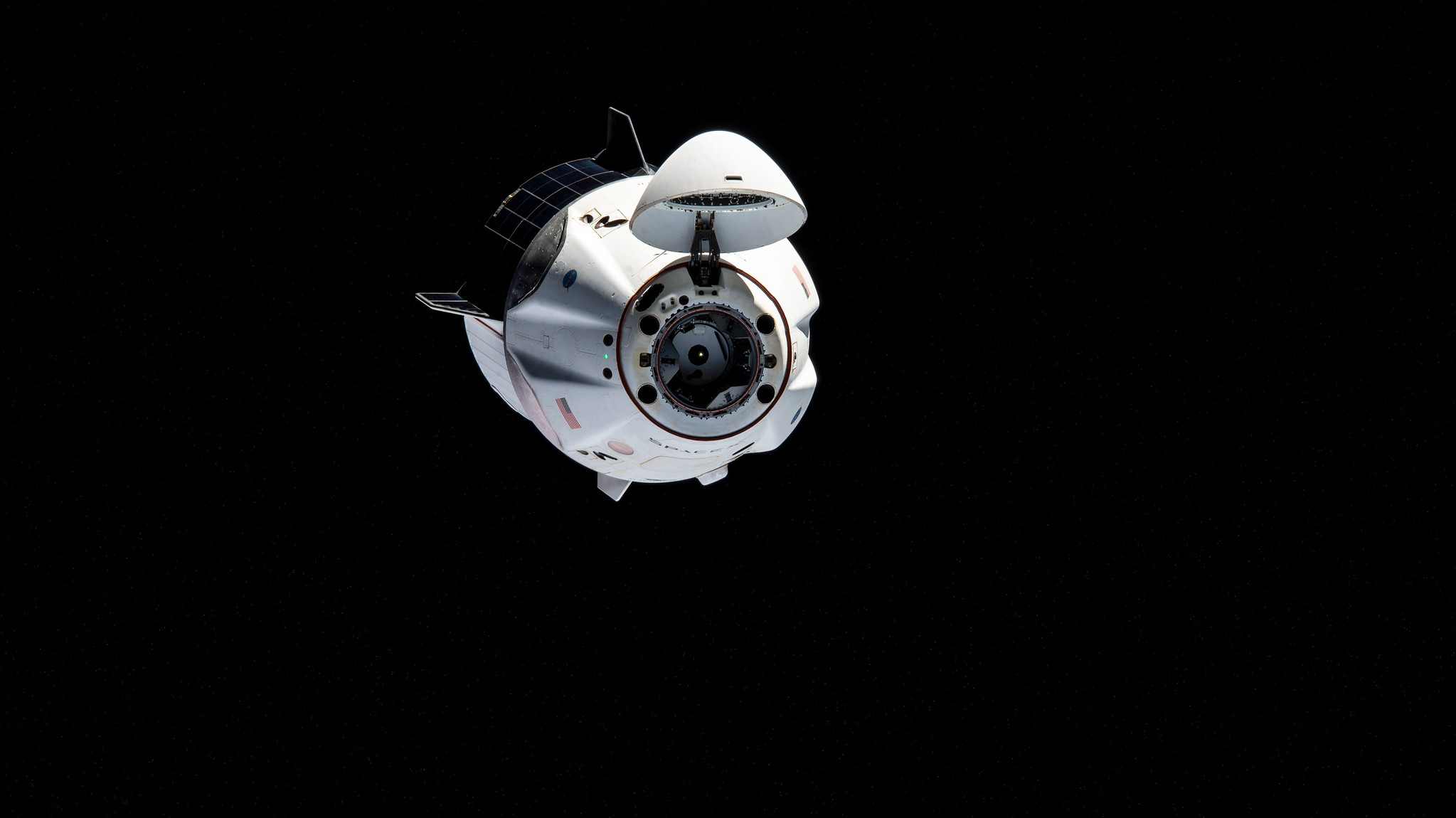 The SpaceX Crew-1 Dragon maneuvers to another port on the International Space Station on April 5, 2021