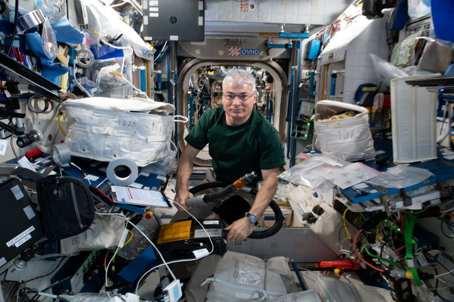 Expedition 65 Flight Engineer Mark Vande Hei is pictured inside the International Space Station's Harmony module working on maintenance activities.