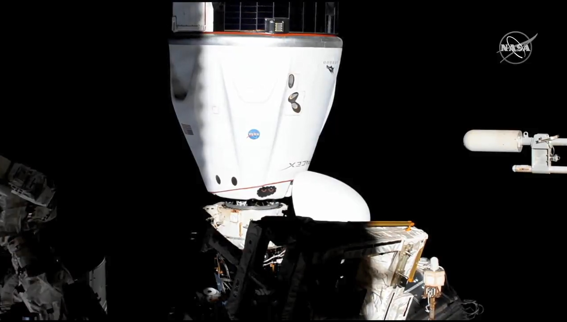 The SpaceX Crew-2 Dragon is pictured after maneuvering to the Harmony module's space-facing international docking adapter.