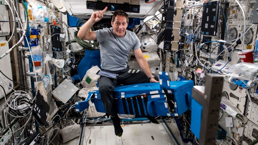 Expedition 65 Flight Engineer Thomas Pesquet of the European Space Agency is pictured inside the Columbus laboratory module setting up hardware for the GRIP experiment.