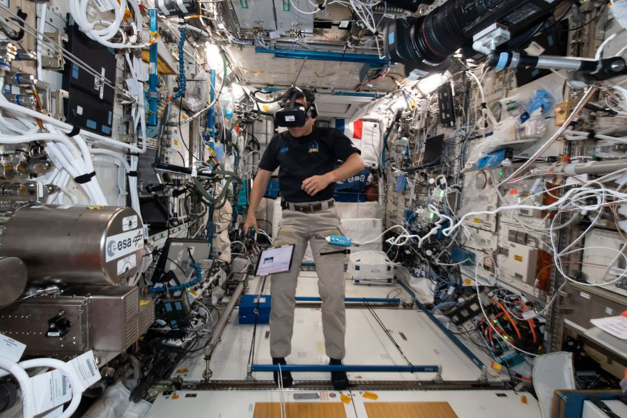 Expedition 65 Commander Akihiko Hoshide, pictured inside the Columbus laboratory module, wears virtual reality goggles for a time perception study.