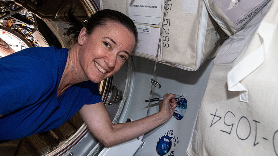 Astronaut Megan McArthur signs her name next to the SpaceX CRS-22 cargo mission sticker before the Cargo Dragon's departure last week.
