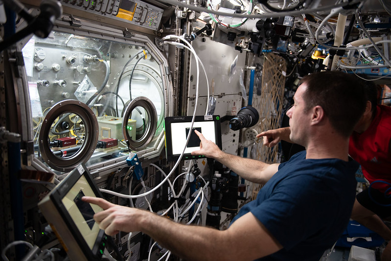 Expedition 65 Flight Engineer Thomas Pesquet of ESA (European Space Agency) works with a science experiment within the Microgravity Science Glovebox. Credits: NASA