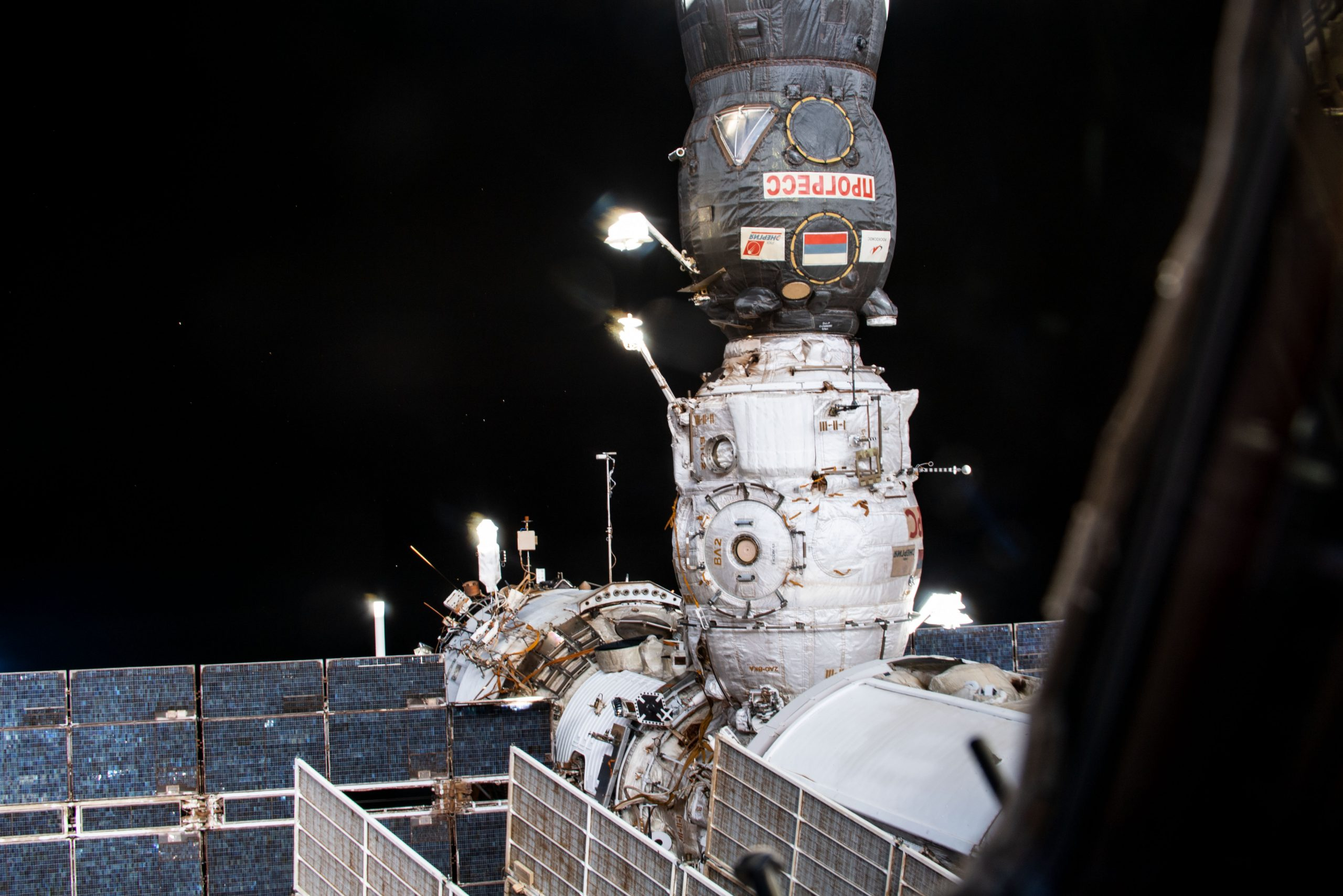 Russia's ISS Progress 77 (77P) cargo craft is pictured docked to the Pirs docking compartment on the station's Russian segment.
