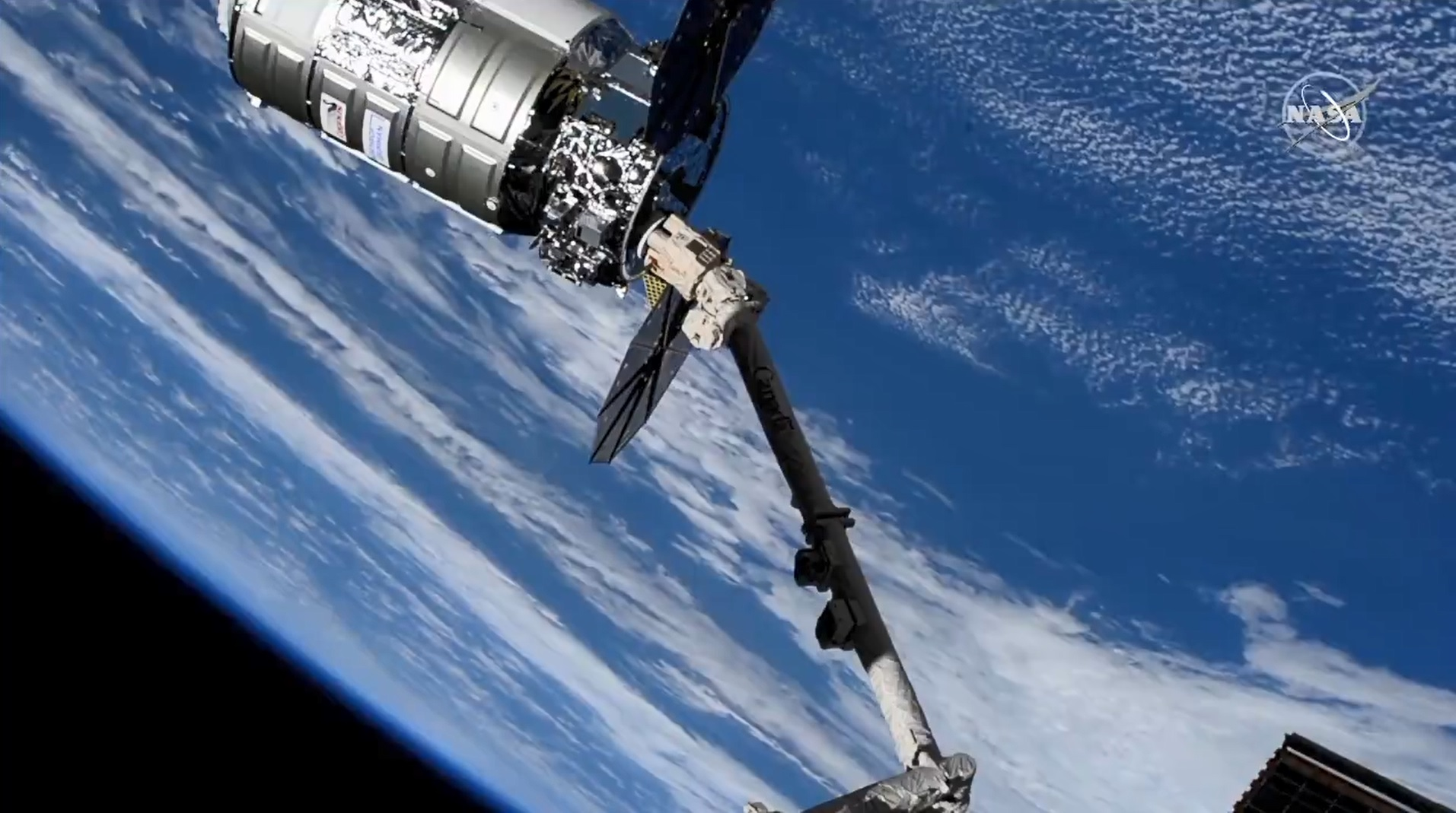The Cygnus space freighter attached to the station robotic arm following a day-and-a-half trip after its launch from Virginia. Credit: NASA TV