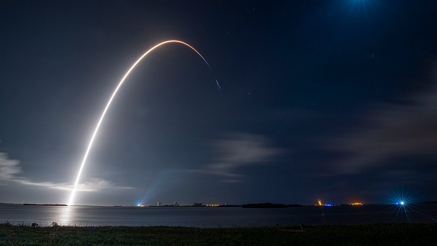 This long-duration photograph shows the SpaceX Falcon 9 rocket launching the Cargo Dragon spacecraft from NASA's Kennedy Space Center into Earth orbit. Credit: SpaceX