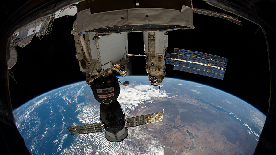 Russia's Soyuz MS-18 crew ship (foreground) and Nauka Multipurpose Laboratory Module are pictured docked to the station as it orbited above Africa's Indian Ocean coast.