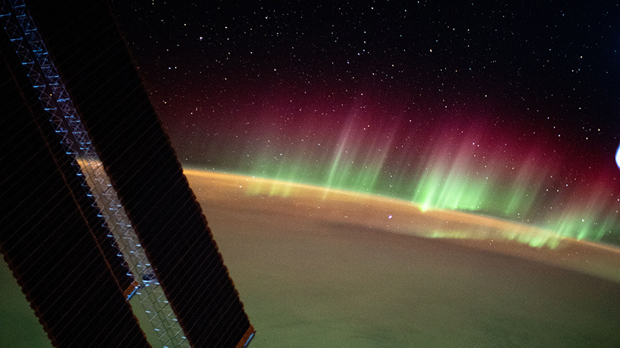 The aurora australis seemingly crowns the Earth's horizon as the station orbited above the southern Indian Ocean in between Asia and Antarctica.