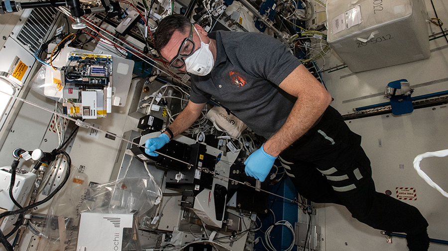 Astronaut Shane Kimbrough works on the Mochii miniature electron microscope to support spectroscopic investigations aboard the space station.