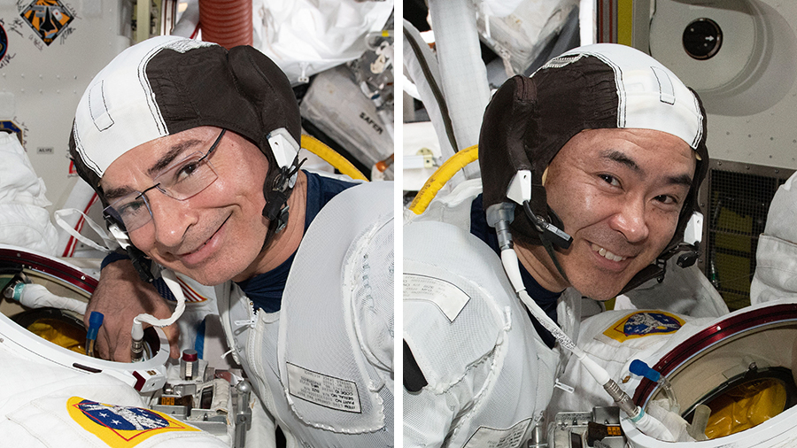 Astronauts Mark Vande Hei and Akihiko Hoshide check their U.S. spacesuits to get ready for a spacewalk prepare the station for its third Roll-Out Solar Array.