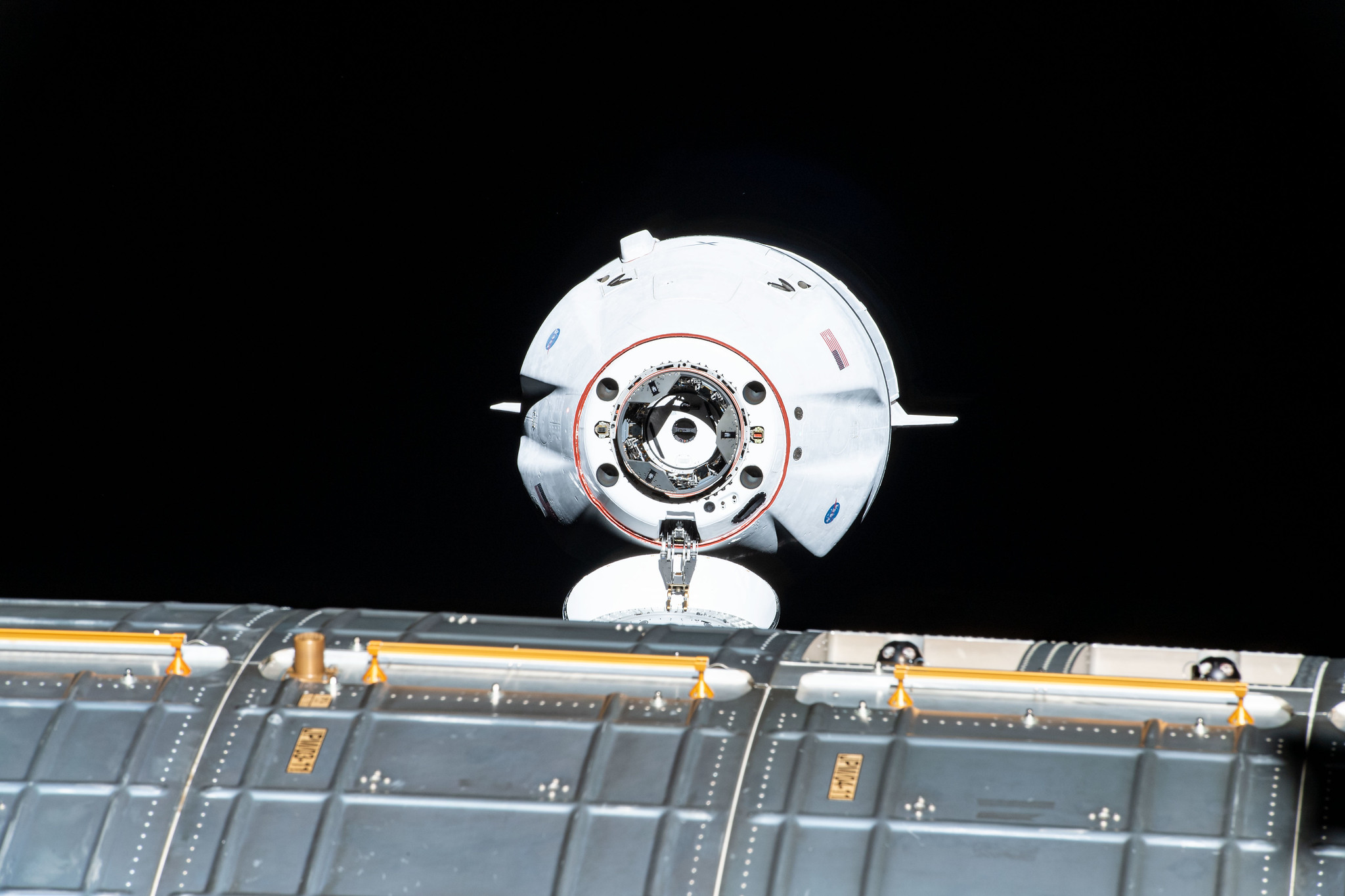 The SpaceX Cargo Dragon vehicle approaches the International Space Station for an autonomous docking to the Harmony module's forward international docking adapter