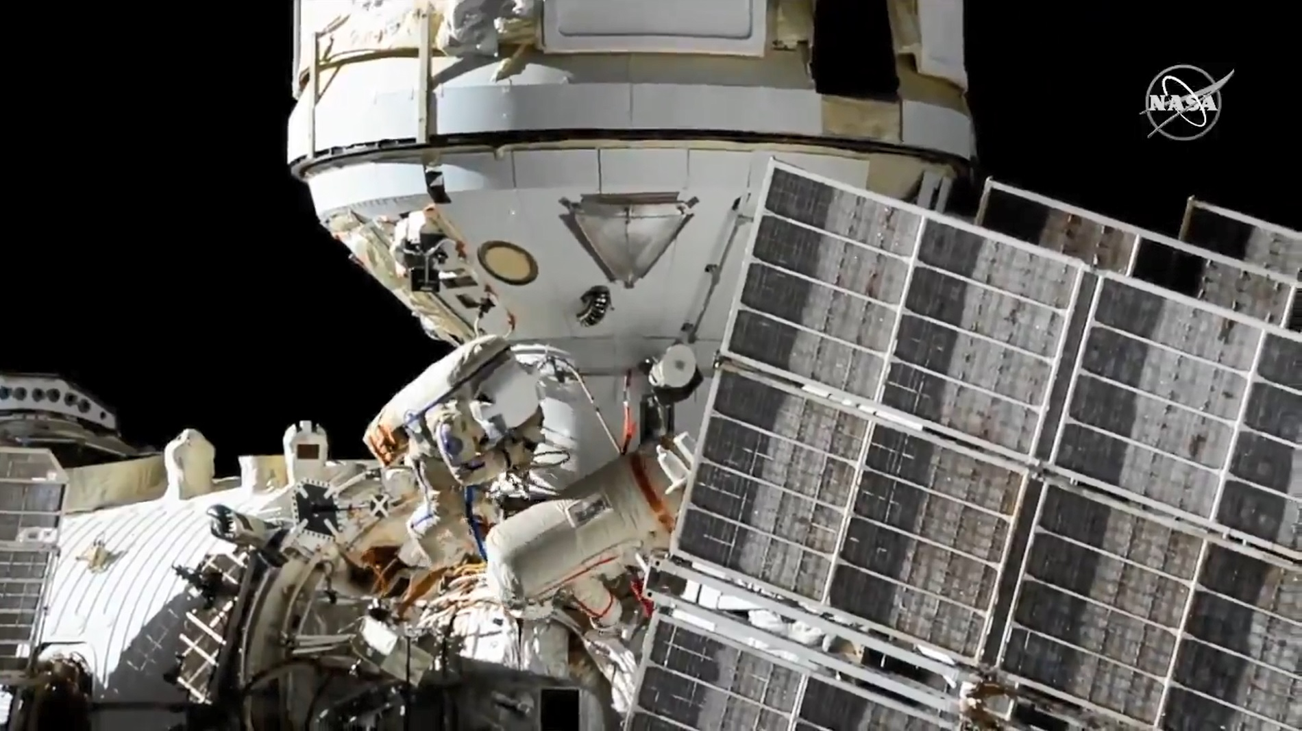 Cosmonauts Oleg Novitskiy and Pyotr Dubrov during a spacewalk to connect power and ethernet cables to the Nauka laboratory module.