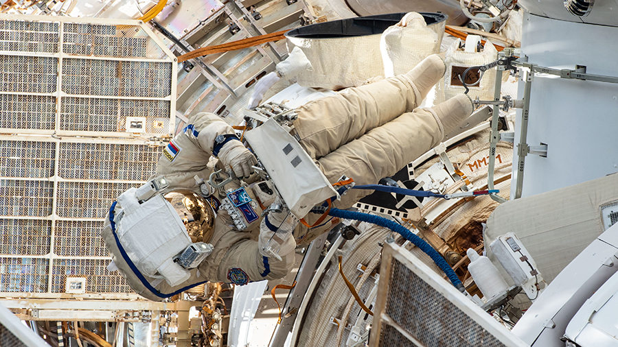 Russian spacewalker Pyotr Dubrov is pictured on Sept. 3 outfitting the Nauka multipurpose laboratory module with ethernet cables, power cables and handrails.