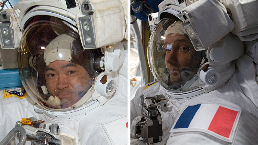 Astronauts (from left) Akihiko Hoshide and Thomas Pesquet are pictured in their U.S. spacesuits preparing for earlier spacewalks.