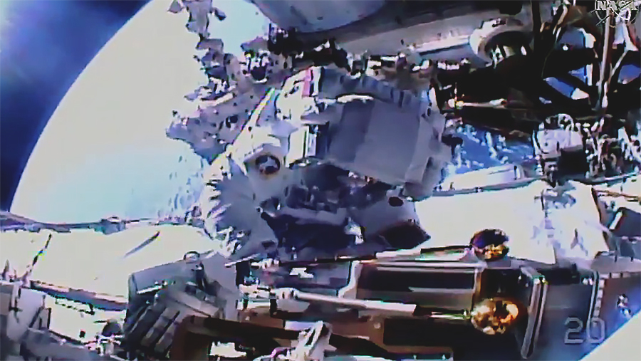 Spacewalker Akihiko Hoshide works on the station's Port-4 truss structure installing a modification kit and preparing it for a future Roll-Out Solar Array. Credit: NASA TV