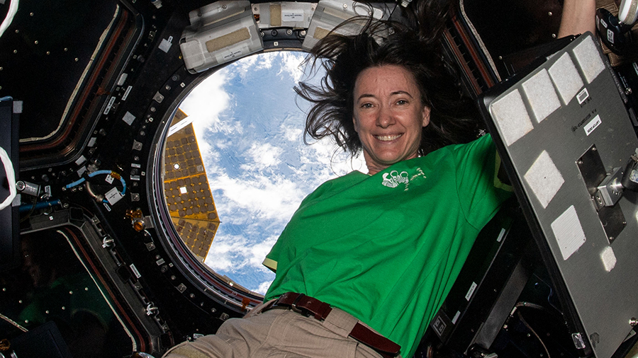 """Astronaut Megan McArthur takes a midday break inside the cupola, the International Space Station's """"window to the world."""""""