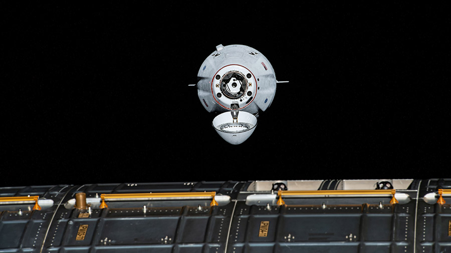 The SpaceX Cargo Dragon vehicle is pictured approaching the station on Aug. 30 for an autonomous docking to the Harmony module's forward international docking adapter.
