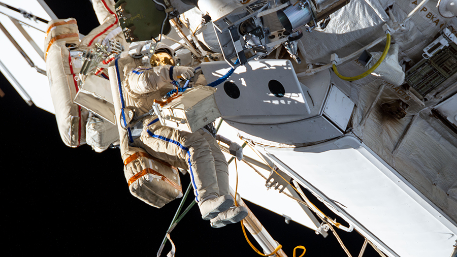 Russian spacewalkers (from left) Oleg Novitskiy and Pyotr Dubrov are pictured on Sept. 3 outfitting the Nauka multipurpose laboratory module with cables and handrails.