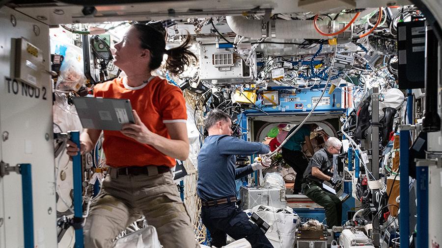 NASA Flight Engineers Megan McArthur, Shane Kimbrough and Mark Vande Hei work inside the U.S. Destiny laboratory module.