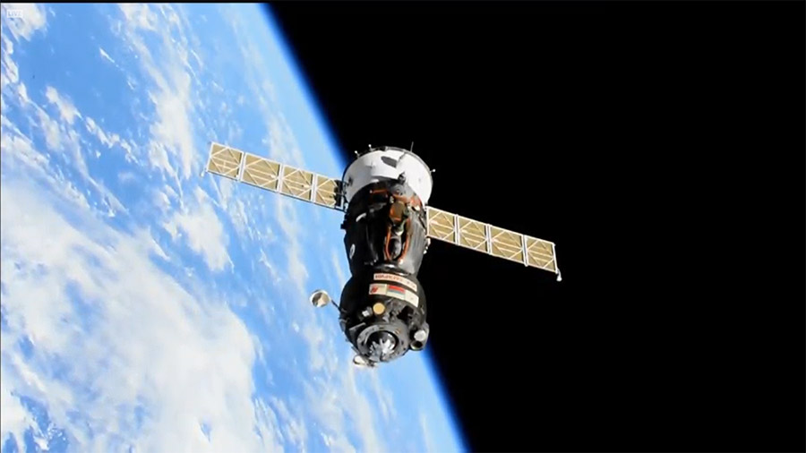 The Soyuz MS-18 spacecraft with three Expedition 65 crewmates inside backs away from the station to relocate to a new docking port.