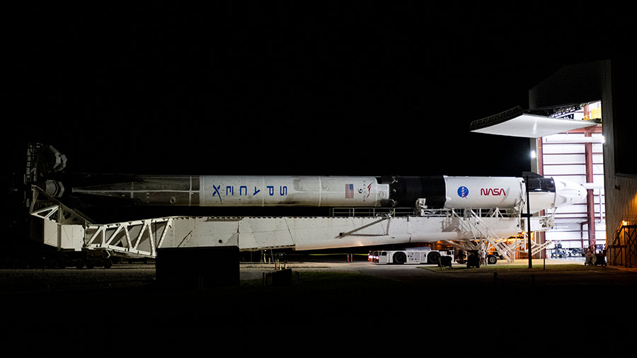 The SpaceX Falcon 9 rocket with the Crew Dragon Endeavour attached rolls out to the launch pad at Kennedy Space Center in Florida. Credit: NASA/Joel Kowsky