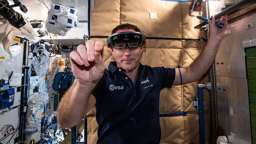 Astronaut Thomas Pesquet wears augmented reality goggles that assist crew members with science experiments and orbital maintenance tasks.
