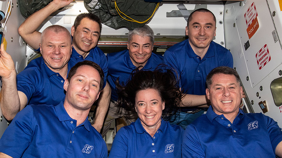The seven-member Expedition 65 crew posed for a portrait aboard the space station on Oct. 4, 2021.