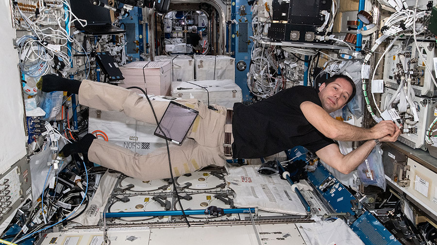 Expedition 65 Commander Thomas Pesquet installs fluid physics and materials research gear inside the Kibo laboratory module.