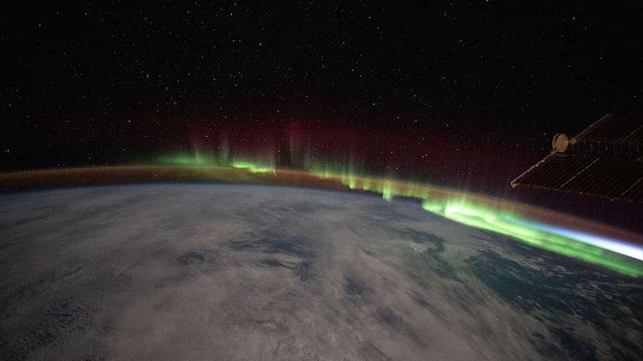 An aurora streams over the Earth as the space station orbited above the southern Indian Ocean in between Australia and Antarctica.