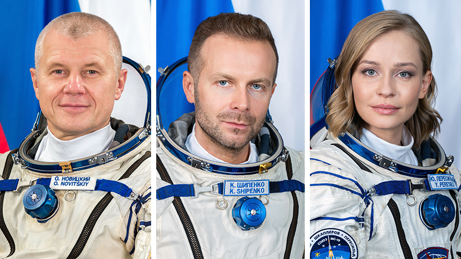 (From left) Roscosmos cosmonaut Oleg Novitskiy and spaceflight participants Klim Shipenko and Yulia Peresild are returning to Earth inside the Soyuz MS-18 crew ship.