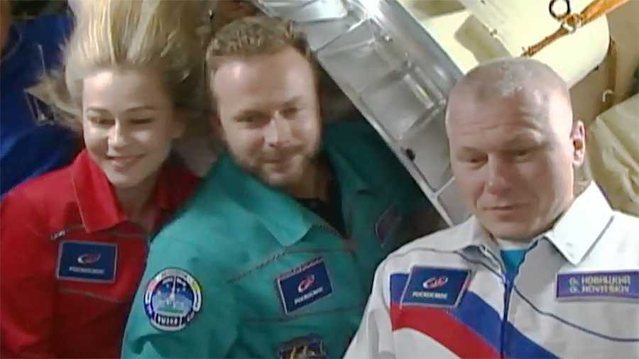 (From left) Spaceflight participants Yulia Peresild and Klim Shipenko and Roscosmos cosmonaut Oleg Novitskiy are pictured moments before entering the Soyuz MS-18 crew ship.
