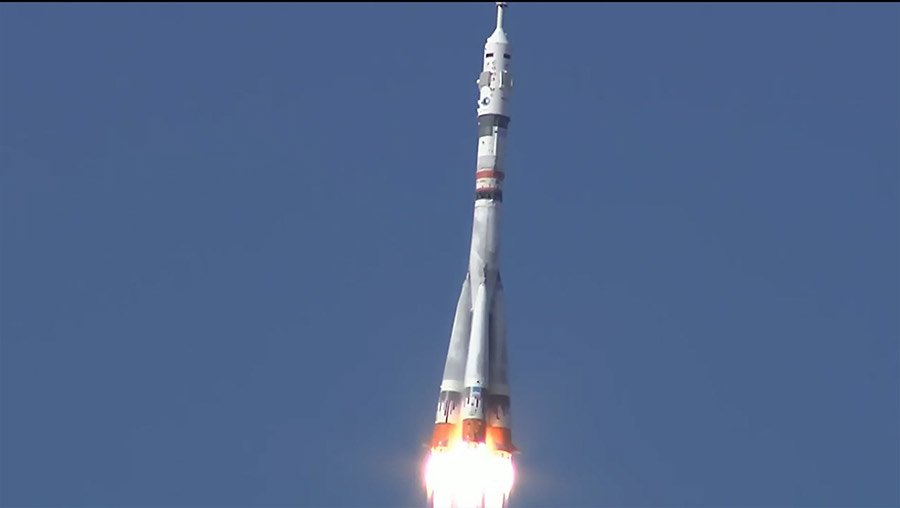 The Soyuz MS-19 rocket with three Russian crewmates aboard ascends into space shortly after launching under clear blues skies in Kazakhstan.