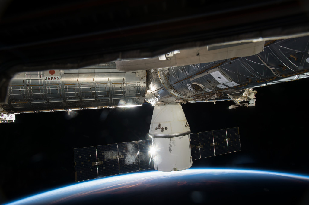 SpaceX's Dragon cargo capsule is seen here docked to the Earth facing port of the station's Harmony module on the company's sixth commercial resupply flight