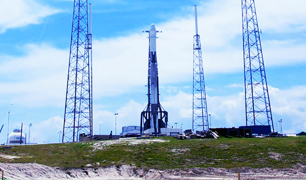 A Falcon 9 rocket stands ready for liftoff