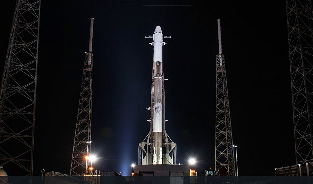 The SpaceX Falcon 9 rocket and Dragon spacecraft await liftoff from Space Launch Complex 40 at Cape Canaveral Air Force Station.